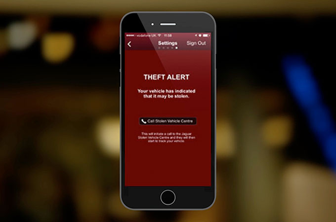 Close-up of Jaguar InControl Theft Alert on Smartphone.