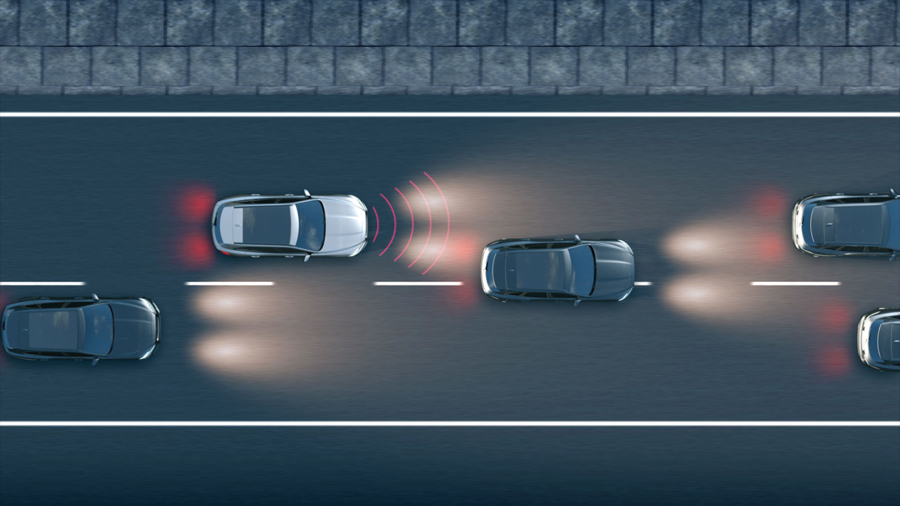 three cars driving on a road.