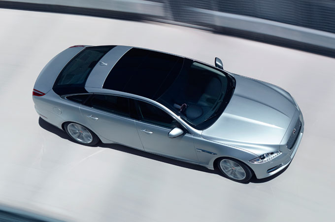 Aerial view of a Silver Jaguar XJ.