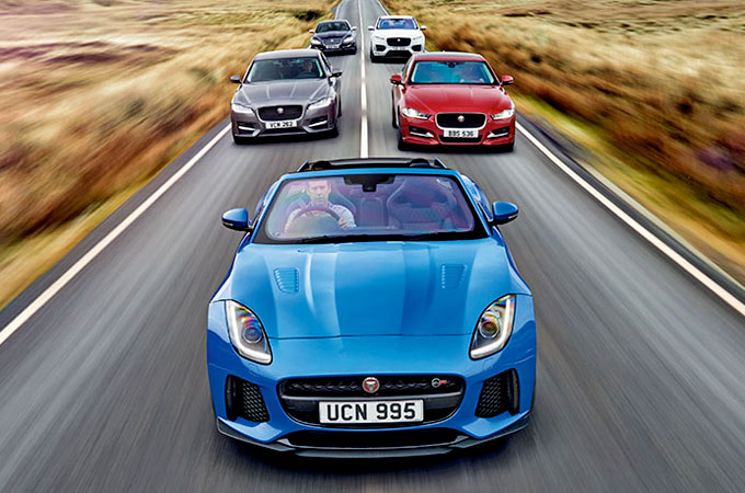 Jaguar's All-Wheel Drive range, drive down a winding road.