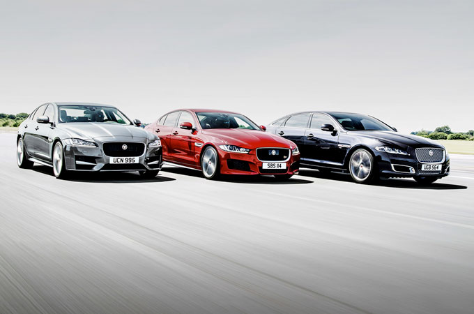 Jaguar's saloon family, race side-by-side along a strip of tarmac.