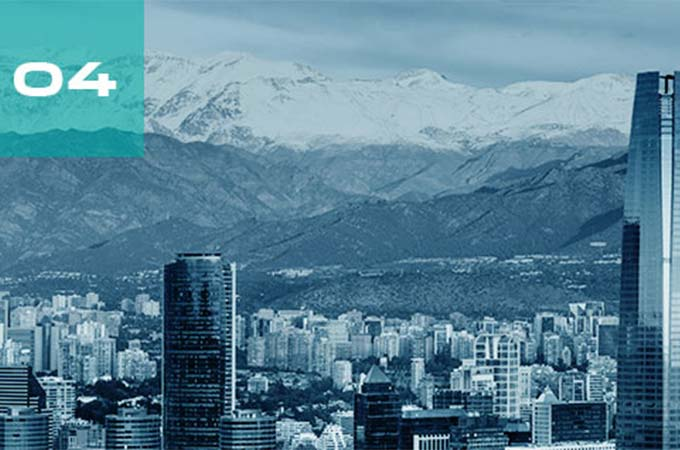 Snowy mountains overlook a city view of Santiago, Chile.