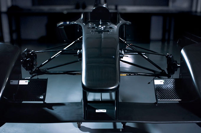 A dimly-lit front view of the Jaguar Racing I-TYPE 2 chassis.