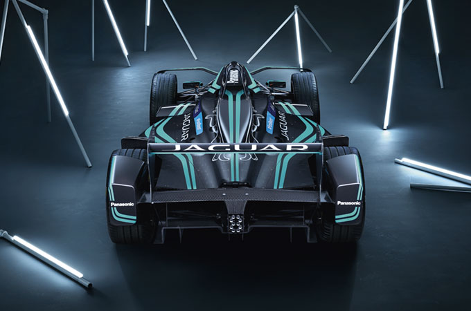 Rear view of the Jaguar I-TYPE 2, in a darkened room, with lighting rods.