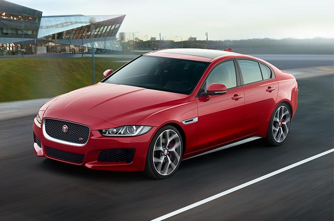 Jaguar XE driving on a track.