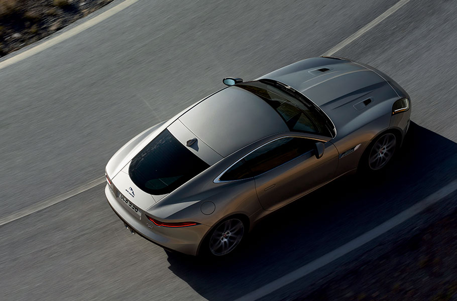 Jaguar F-TYPE Coupe driving on road