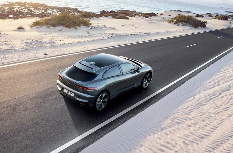 Jaguar Grey all electric I-PACE driving on road