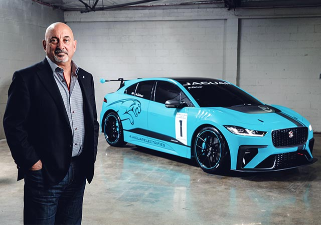 Bobby Rahal standing in front of Jaguar I-PACE eTROPYHY