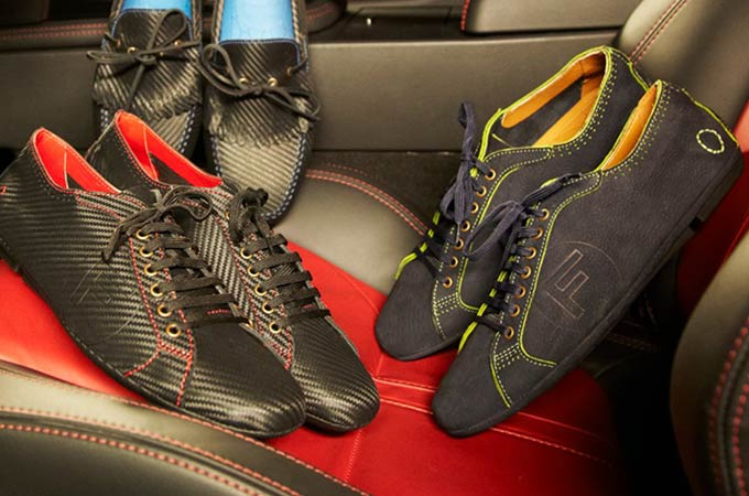 A selection of the shoes from the Jaguar Oliver Sweeney range placed on a car seat.