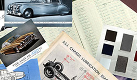 Vintage identification documents for classic vehicles.