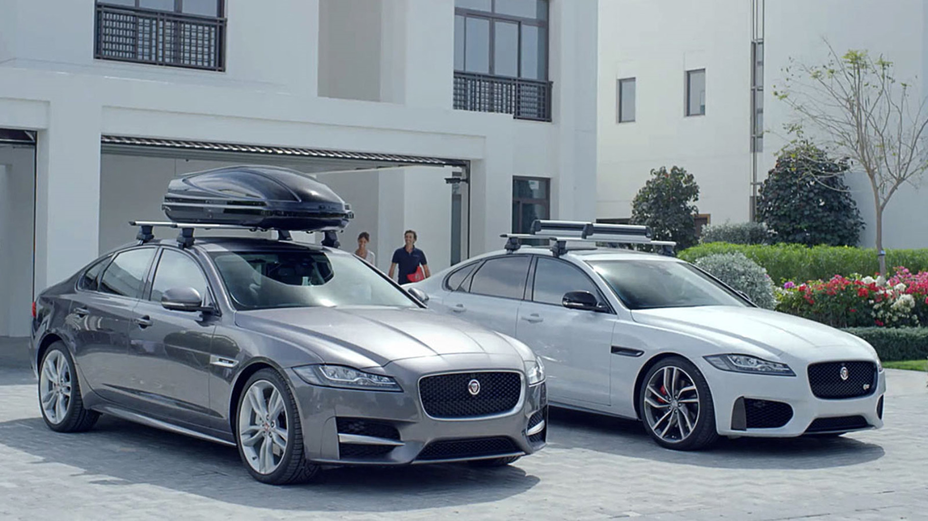Two Jaguar XF Saloons parked with fitted accessories.