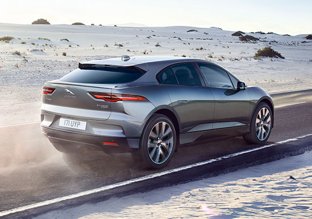 Jaguar I-PACE drives on a sandy open road
