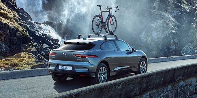 Jaguar I-PACE carries a bicycle atop the roof, utilising its capability for accessories