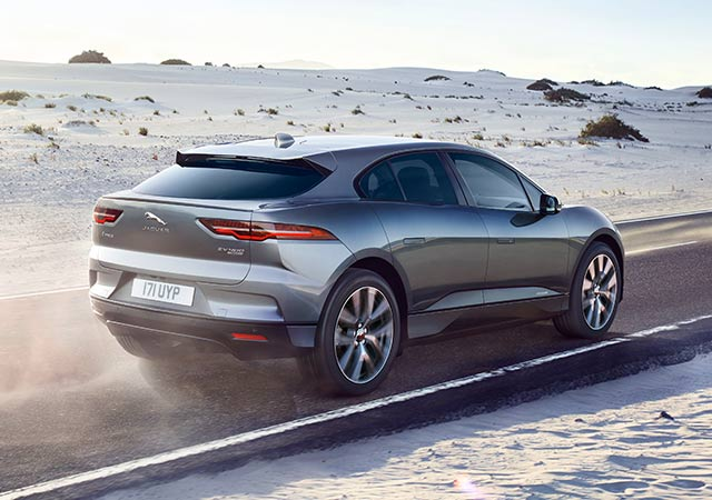 Jaguar I-PACE drives along a sandy open road