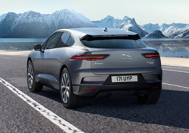 Rear View of Jaguar All Electric I-PACE driving on road