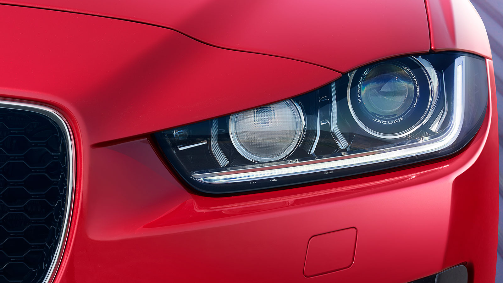 Close-up of Jaguar XE's signature 'J' Blade LED Daytime Running Lights.