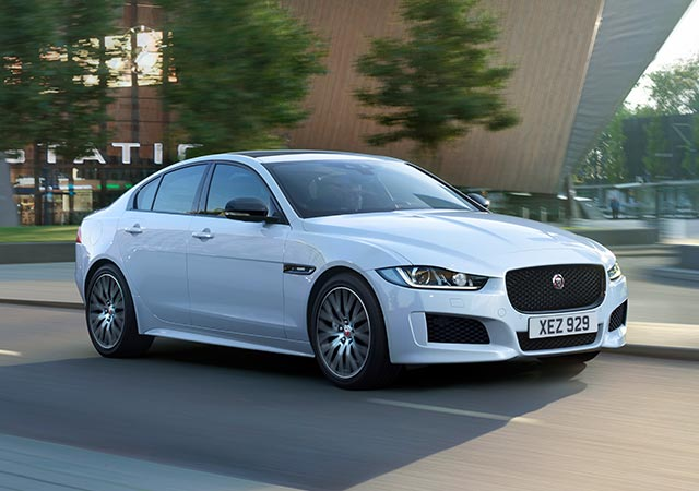 White Jaguar XE driving on city road