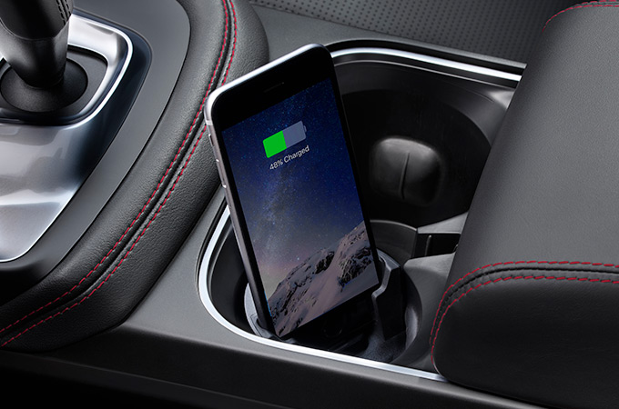 Image of an iPhone docked in the Jaguar E-Pace iPhone Connect and Charge Dock.