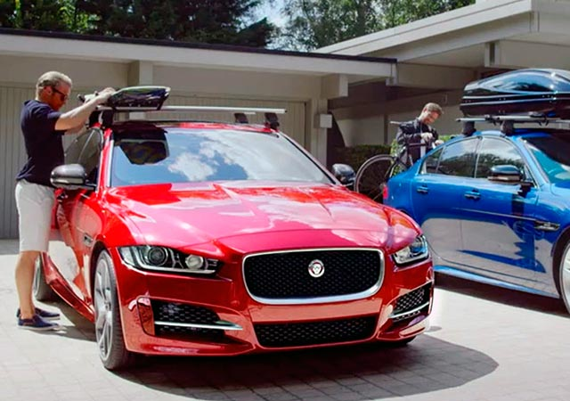 Red and Blue Jaguar XE with compatible Jaguar Gear Roof Accessories