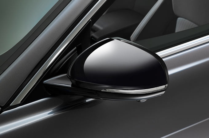 Jaguar XE's gloss black mirror covers.