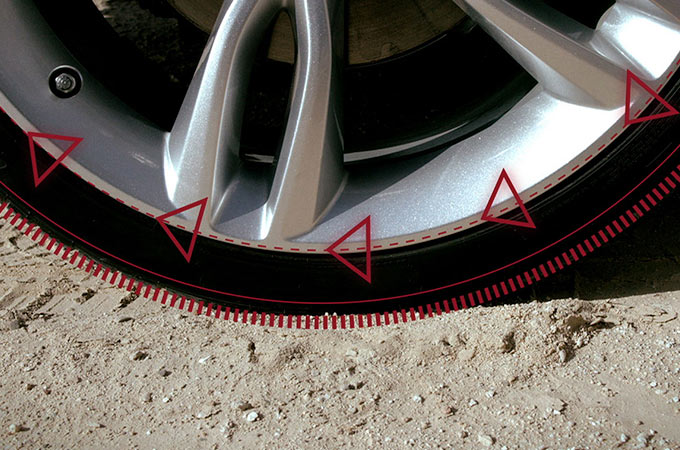 Jaguar XE tyre, on gravel.