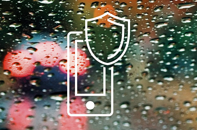 Jaguar's Protect symbol, in front of raindrops.