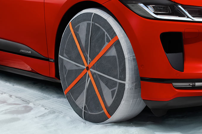 JAGUAR I-PACE WHEEL WITH SNOW SOCK WINTER TRACTION AID.