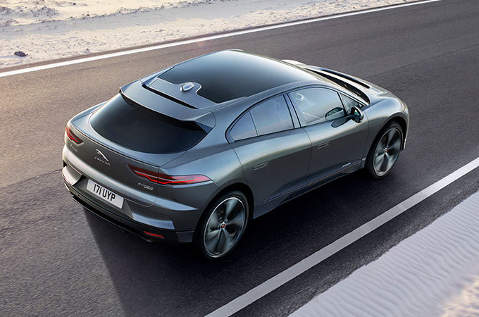 A Jaguar I-Pace driving down a road.