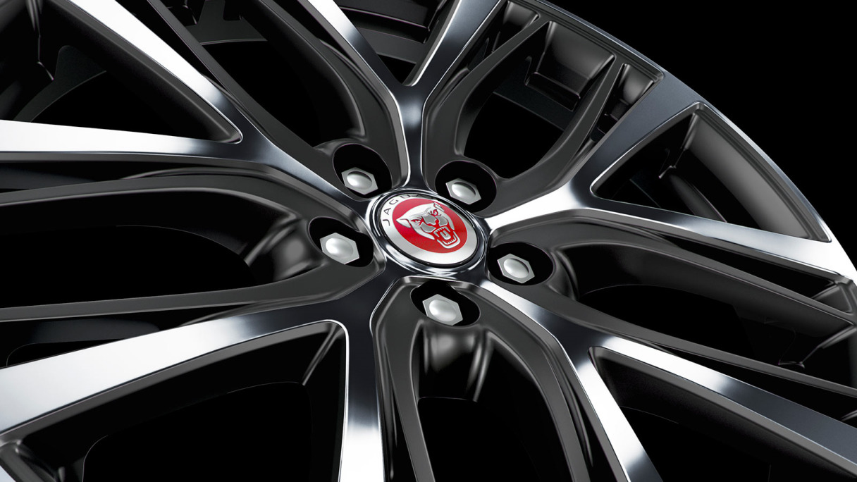 Close up of a Jaguar I-Pace Wheel with Growler center badge.