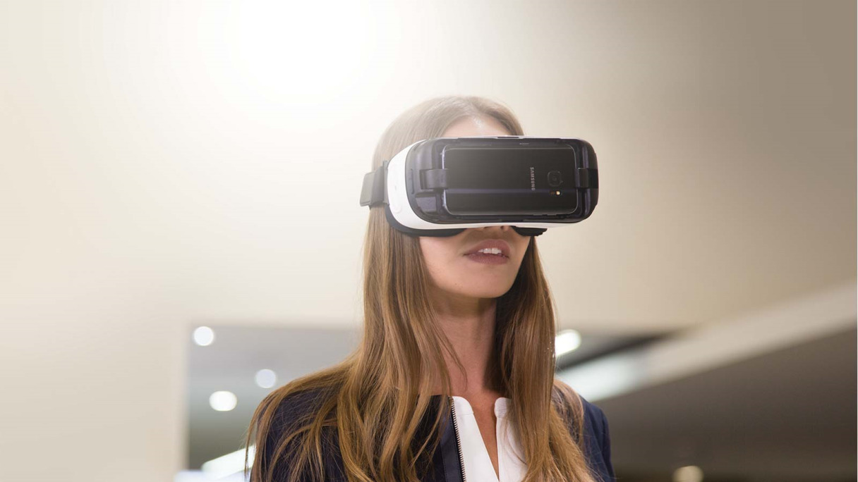 Jaguar E-Pace - woman wearing VR headset for VR Experience.