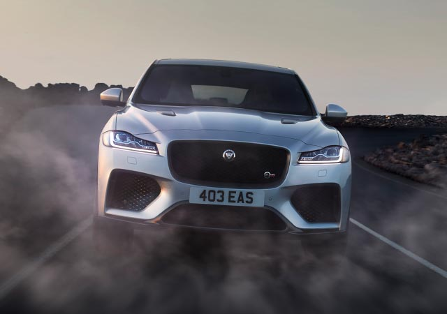 Grey Jaguar F-PACE driven on desert open road