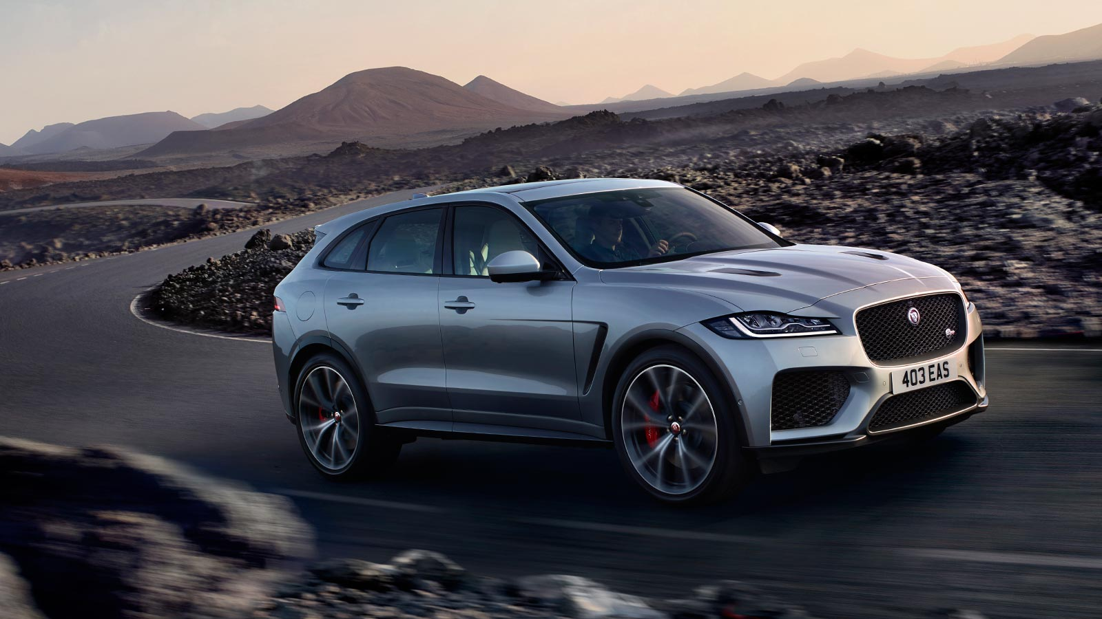 Grey Jaguar F-PACE SVR driven on desert open road