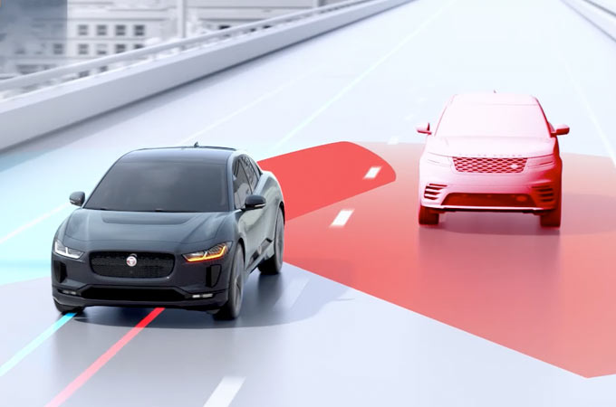 Jaguar I-PACE Blind Spot Assist Detecting Approaching Vehicle.