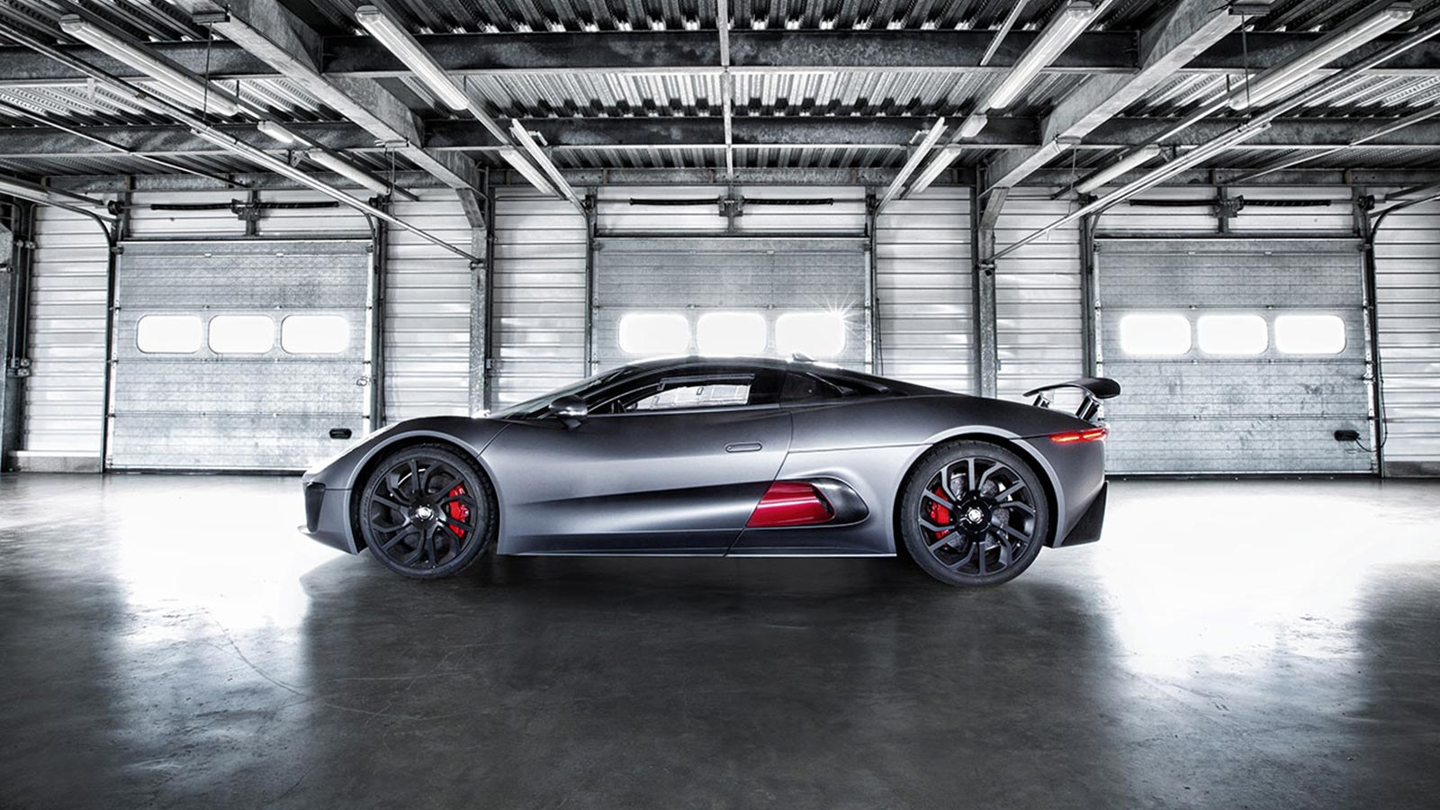 Jaguar C-X75 parked in a warehouse.