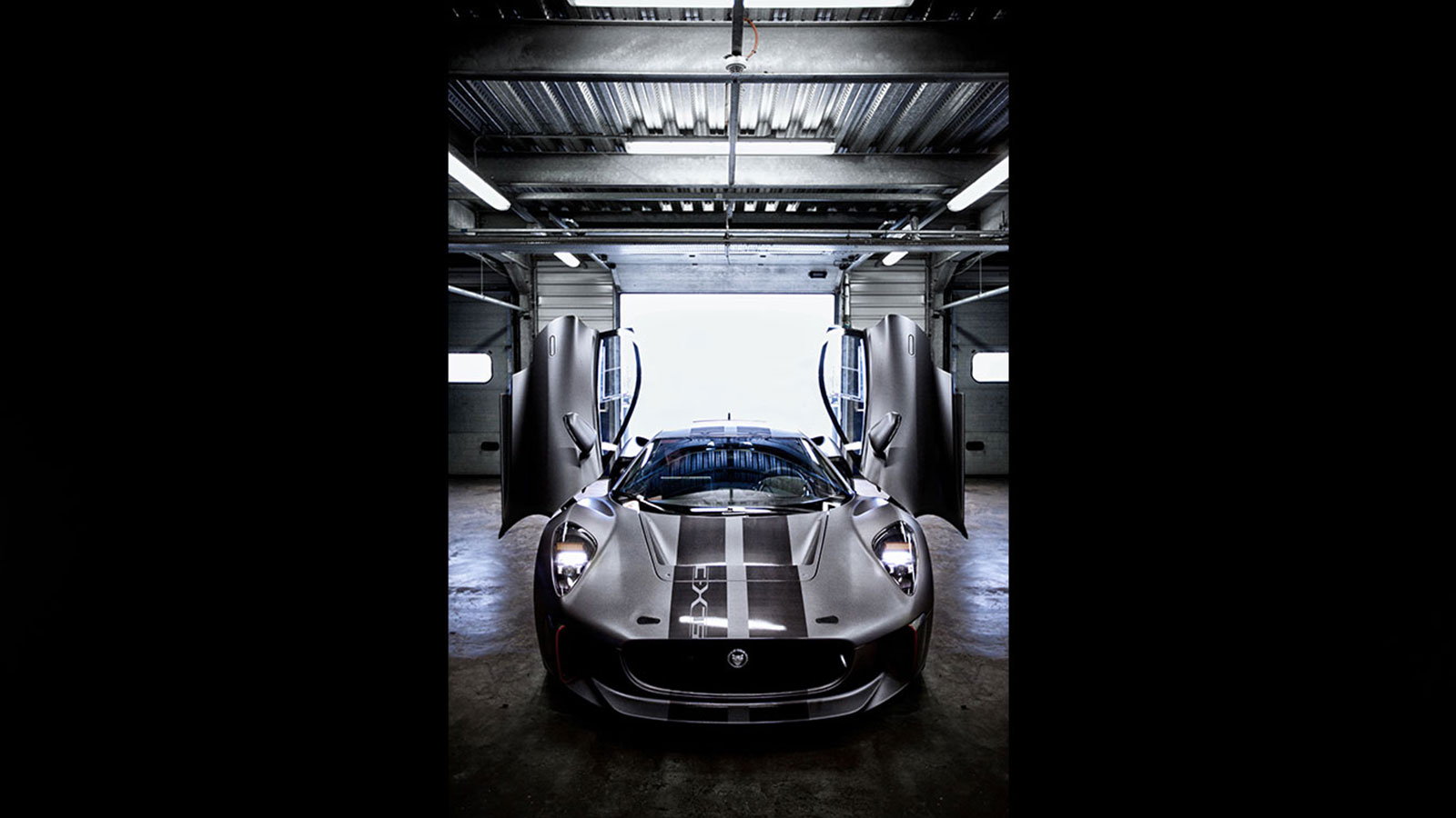 Jaguar C-X75 in warehouse.