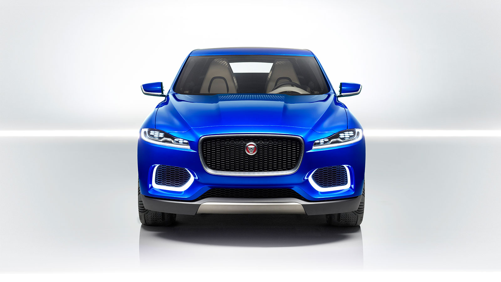 Front shot of a Jaguar C-X17 in blue in a studio.