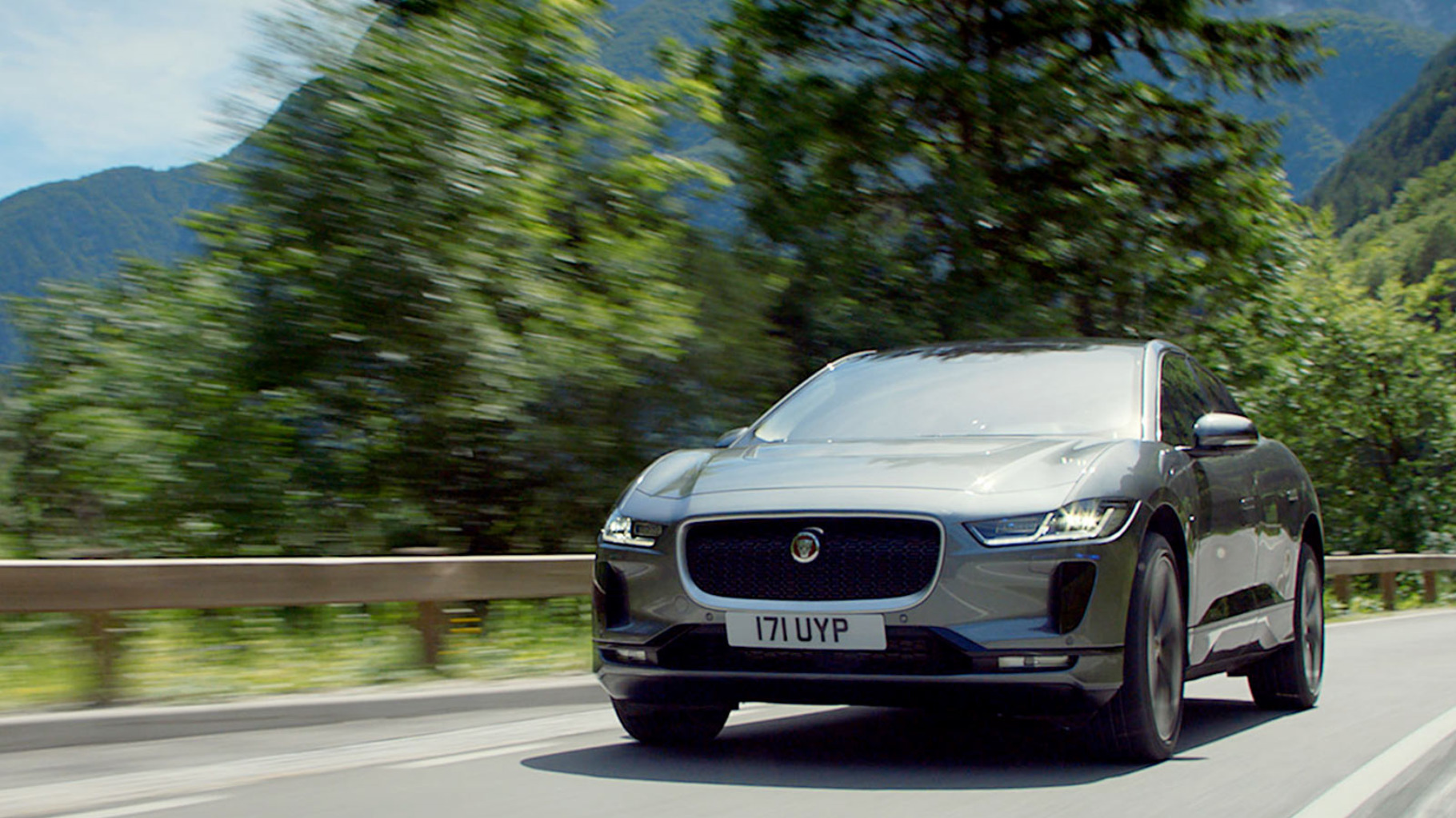 Jaguar I-Pace Driving on a road.