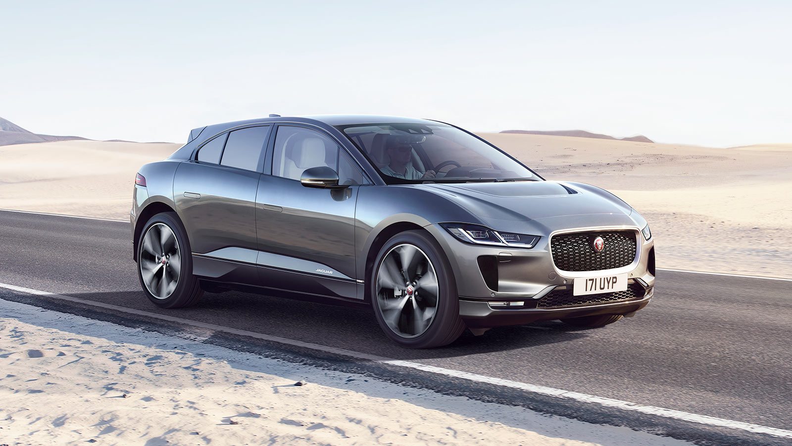 Jaguar I-PACE Front 3 Quarter driving on a road in rough terrain.