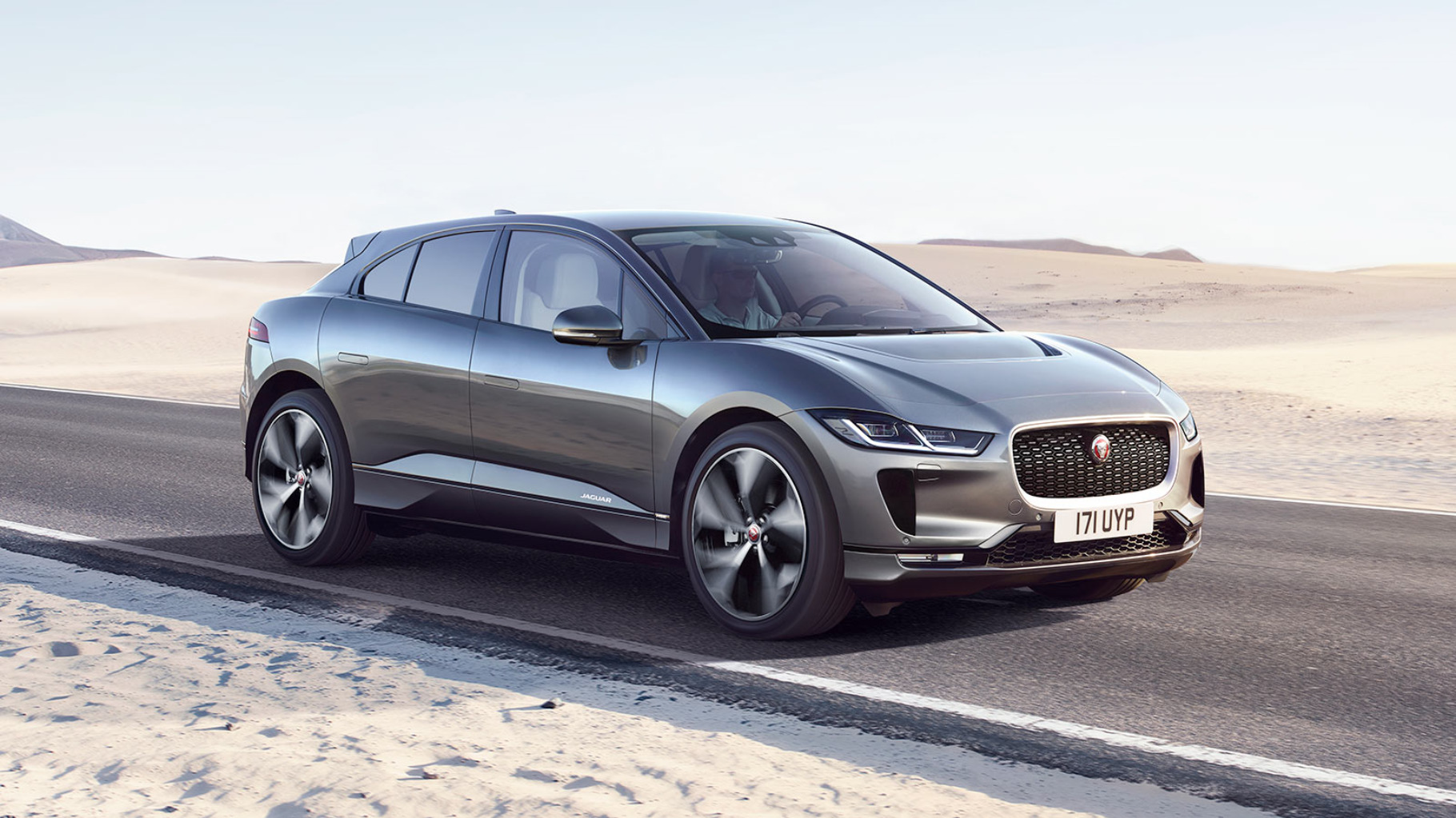 Jaguar I-PACE Front 3 Quarter driving on a road in rough terrain
