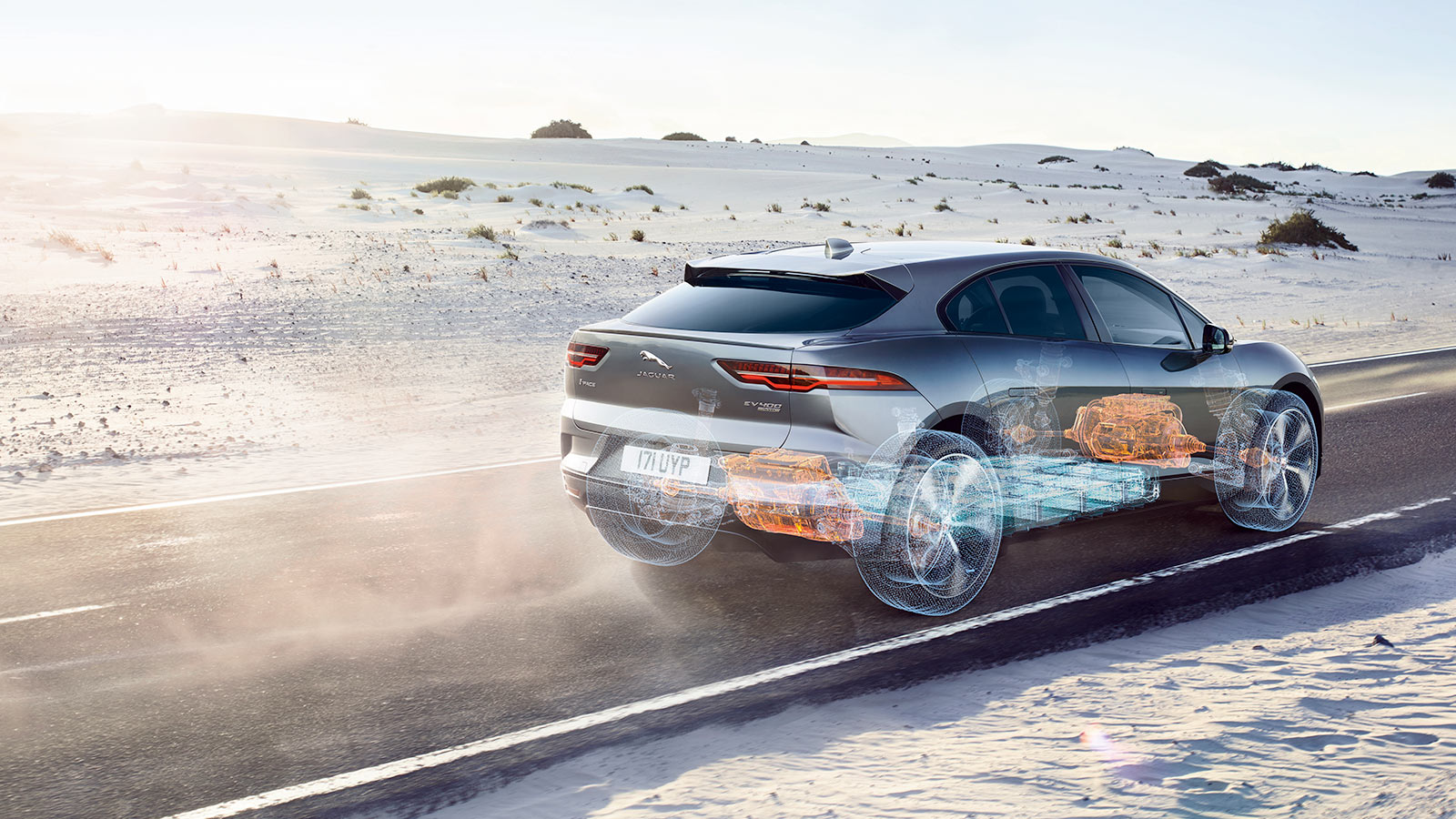 Xray of Jaguar I-Pace Driving on a dusty road.