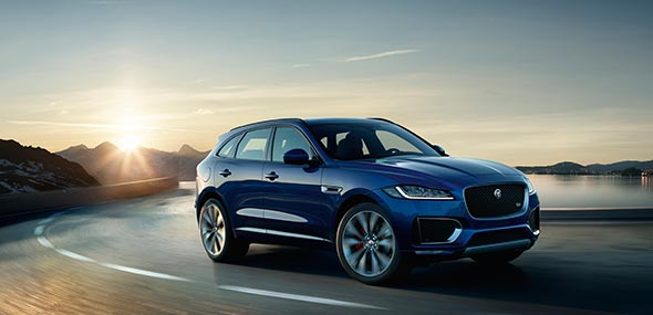 Jaguar Blue F-PACE driven on road