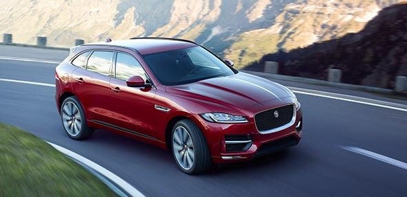 Red Jaguar F-PACE driven on road