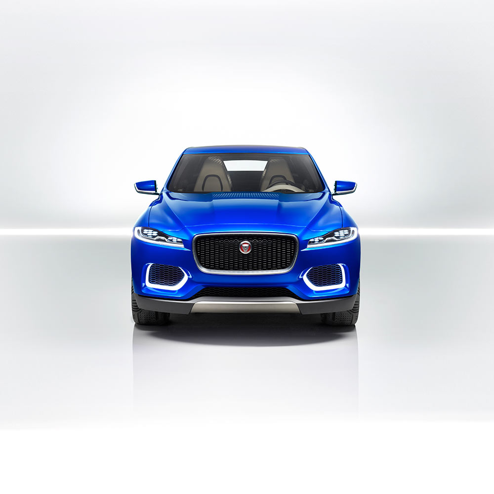 Blue Jaguar C-X17 within white studio.