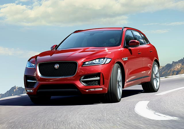 Red Jaguar F-PACE with signature J blade Daytime Running Lights and Adaptive LED headlights