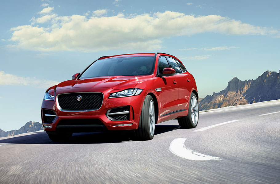 Jaguar Red R-Sport F-PACE driving on road