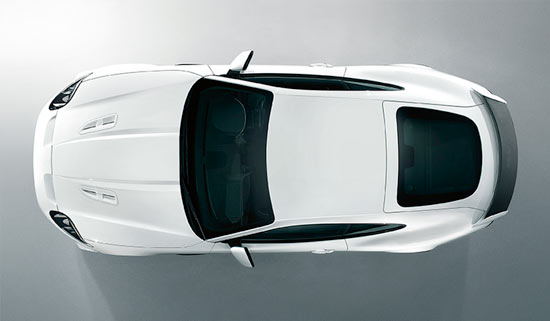 Aerial view of a white Jaguar XK RS.