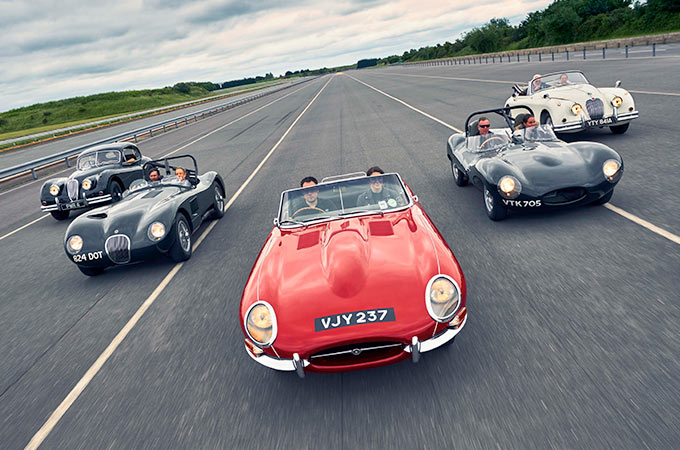 Group of Jaguar Classic vehicles on a race track.