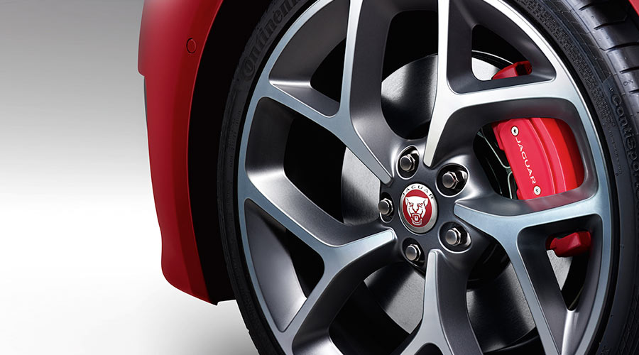 Close up of a jaguar wheel showing red brakes.