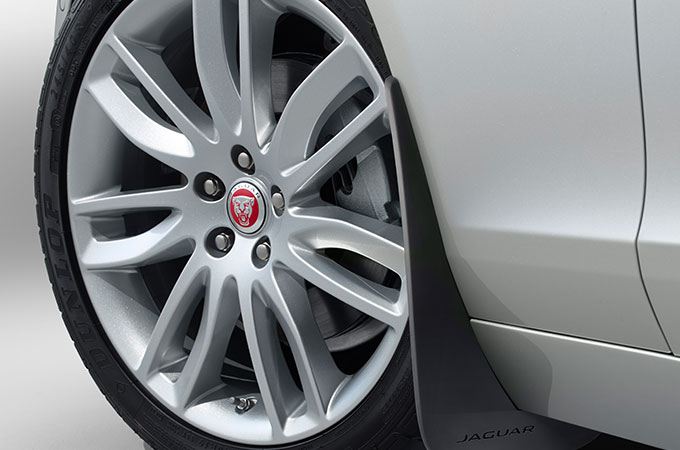 The boot of Jaguar XF Opened to show lifestyle accessories.