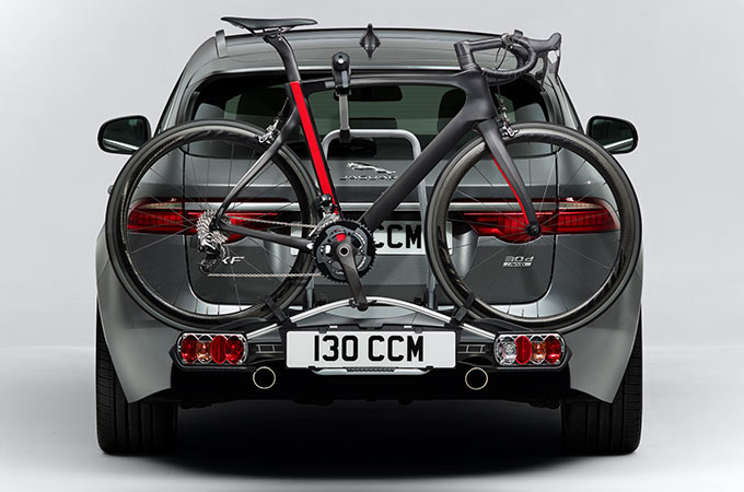 Jaguar XF Sportbrake Towing two bikes.